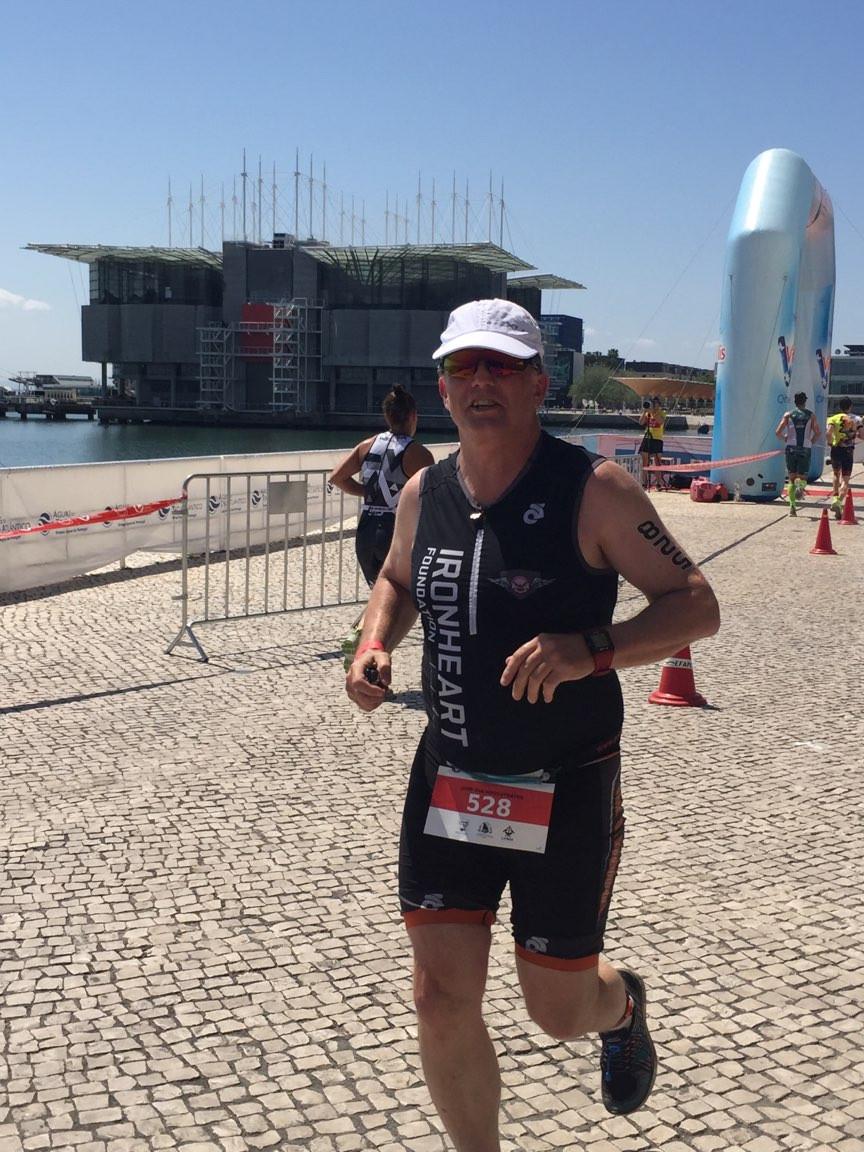 Middle distance triathlete running in Lisbon