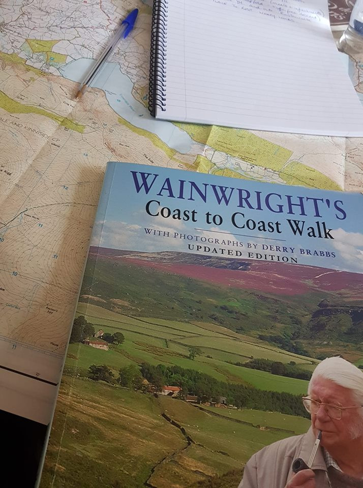 Picture of a map and Wainwrights Coast to Coast book