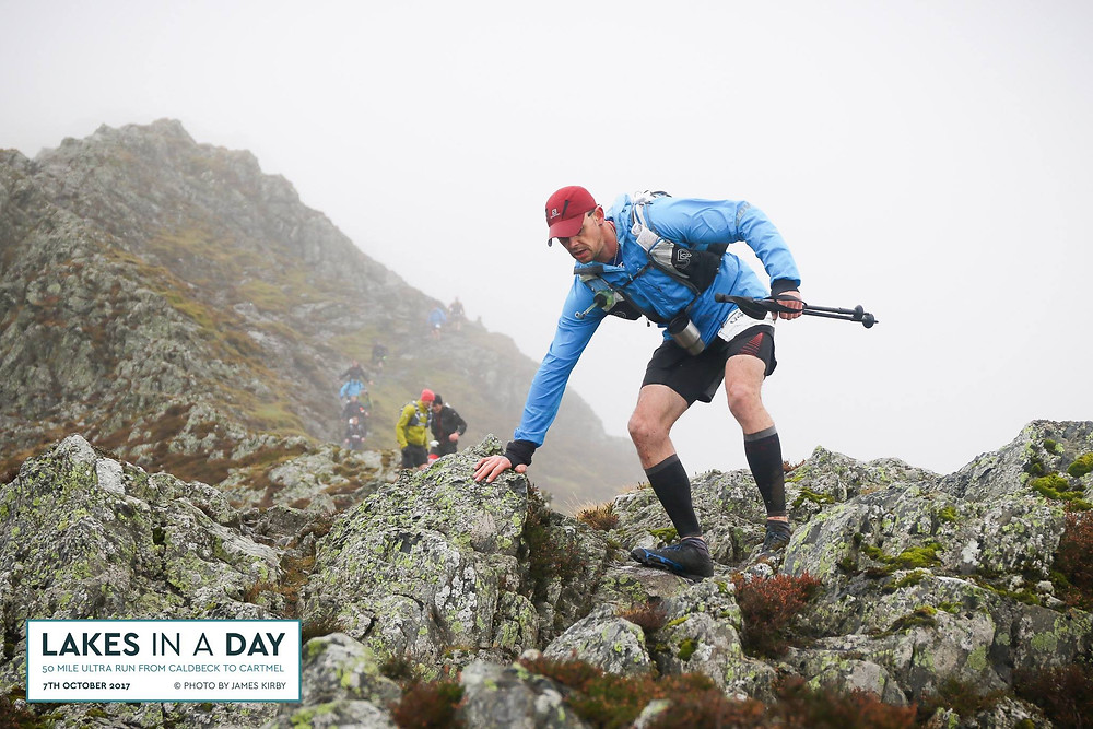 Runner coming down of Halls Fell during the Lakes in a Day running Ultra
