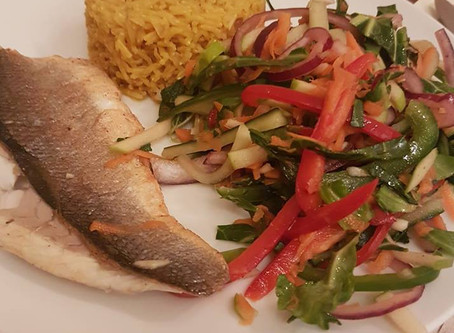 Pan fried sea bass, turmeric rice and Thai themed salad