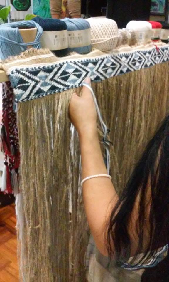 Rae - weaving a korowai 2.jpg