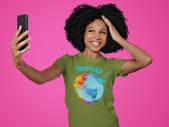 t-shirt-mockup-of-a-happy-woman-taking-a-selfie-at-a-studio-m12678-r-el2 (2).png