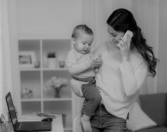 Mom on Phone with Baby BW.jpg