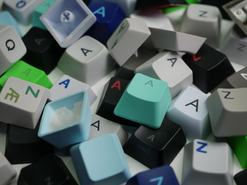 Which keycap material: ABS or PBT?