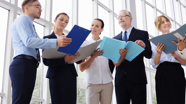 people-work-and-corporate-concept-business-team-with-folders-meeting-and-talking-at-office-building_