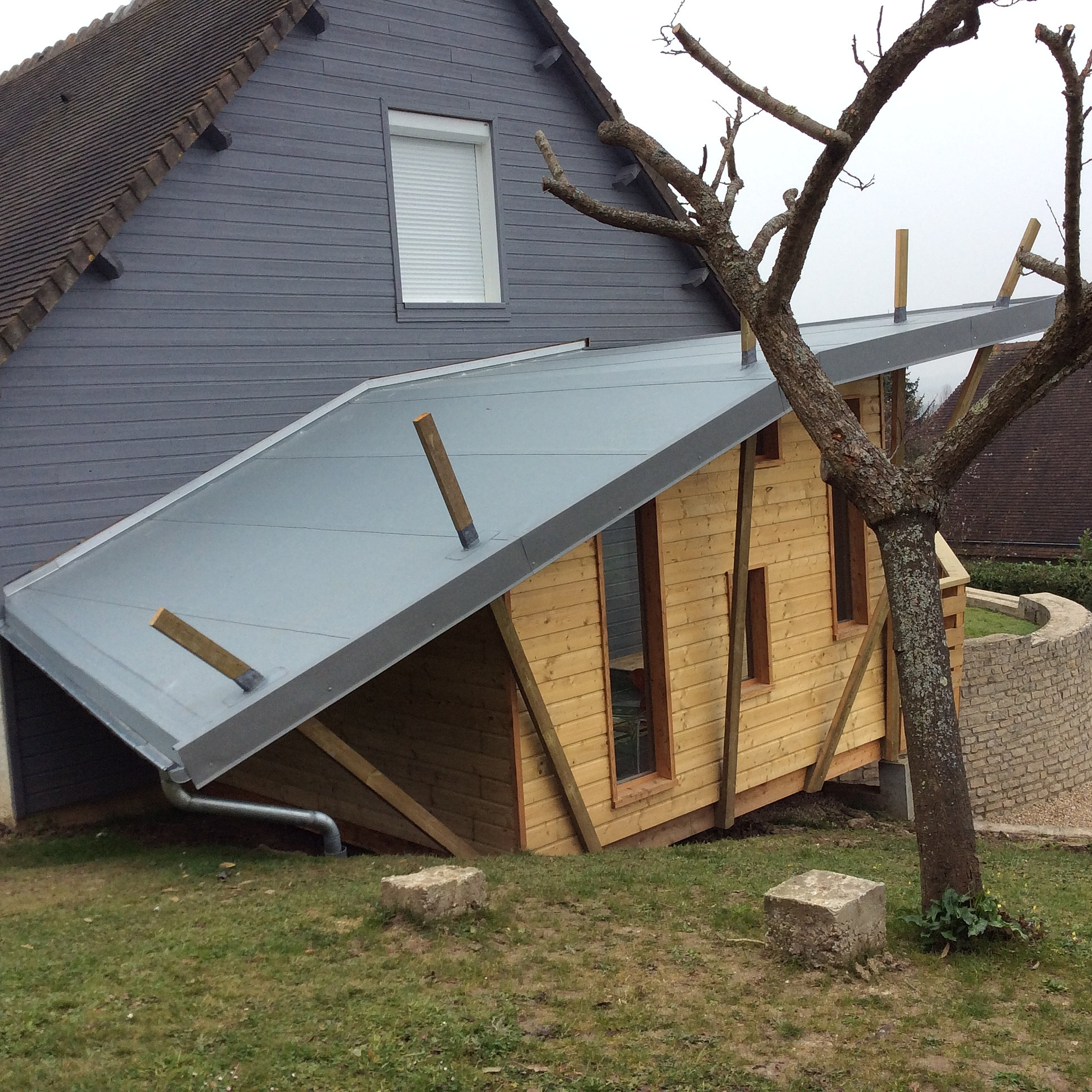 Extension maison ossature bois cliquez de maisons for Prix extension en bois de 25m2