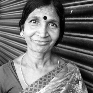 "Jaya, 50+ years old 💌 ""Me and my husband both iron clothes for a living. I'll tell you something, we have taken care of our grandson since he was 2months old. Our eldest daughter was hung to death by her mother in law, and since then we've taken care of him. He doesn't know this and treats us like his own parents. Dhanush is 10 years old now and we are trying to save up to give him a better education, while paying off a loan we had taken from friends and family of 5 lakhs for our youngest daughter's marriage dowry."""