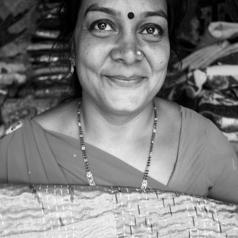 """Usha 💌 """"At the time of our second baby's delivery we didn't even have a single rupee to give the hospital. Somehow we got through it. When our children were 5/2/1 year old respectively, the small stall we work at was our home, we would work during the day with the kids sitting here in the shop and at night shut the stall and sleep here. I still remember we would cook food at night, and eat it cold during the day, we did not have the facilities to give our children hot fresh food. We've come a long way from there and god has been grateful to us. We now have a flat to stay at and hot food to eat."""""""