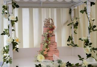 Pink buttercream ganache semi naked wedding cake fresh flowers roses rustic four tier Ashford Kent Cake maker bake to the future Blazing Donkey