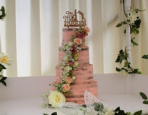 Pink buttercream ganache semi naked wedding cake fresh flowers rustin wedding cake