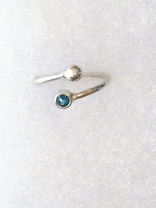 Silver Ring with Faceted Sky Blue Topaz Gemstone