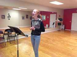 Olivia D. working on her song