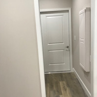 Entrance from garage into laundry room