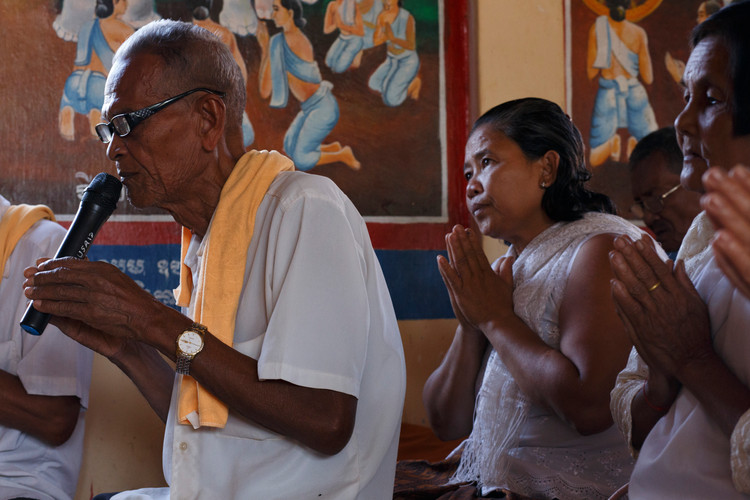 Commune Chief Skonn Sakin leads prayer as the final day of testimonial therapy commences at Ta Ann village, Ta Ann commune,                                  Kralanh district, Siem Reap province, Cambodia.