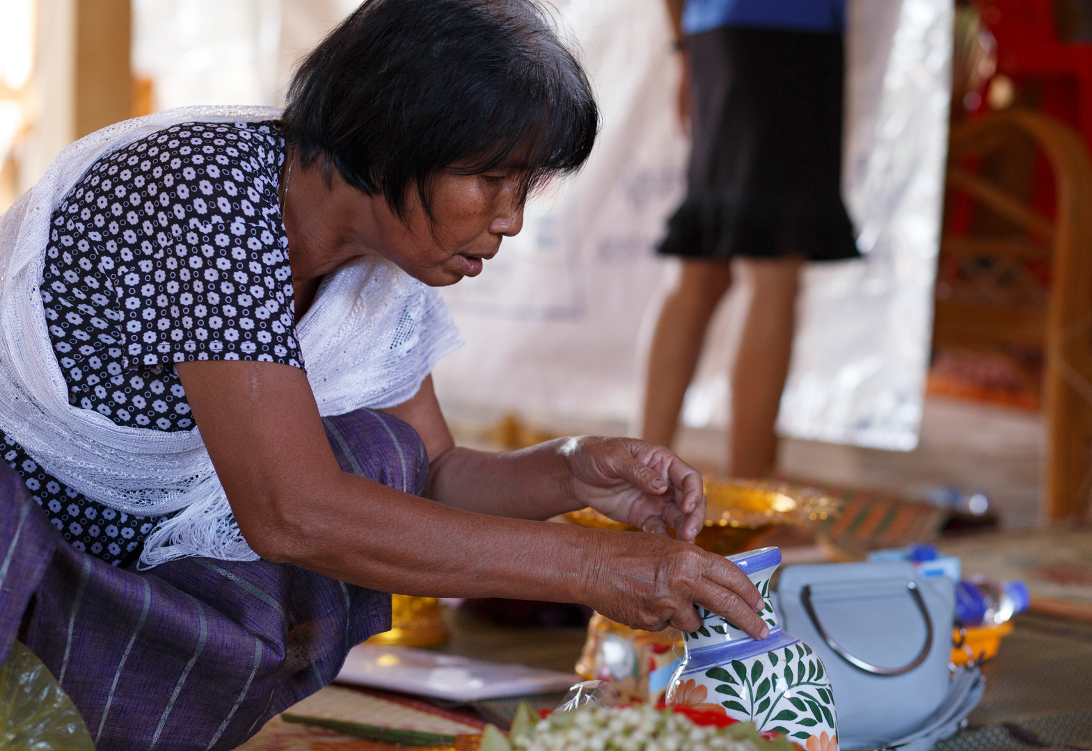 A village member prepares ceremonial petals before a testimonial thereapy ceremony organised by the Transcultural Psychosocial Organisation at Ta Ann Village, Ta Ann Commune, Kralanh district, Siem Reap province, Cambodia on the 18th of January 2018.