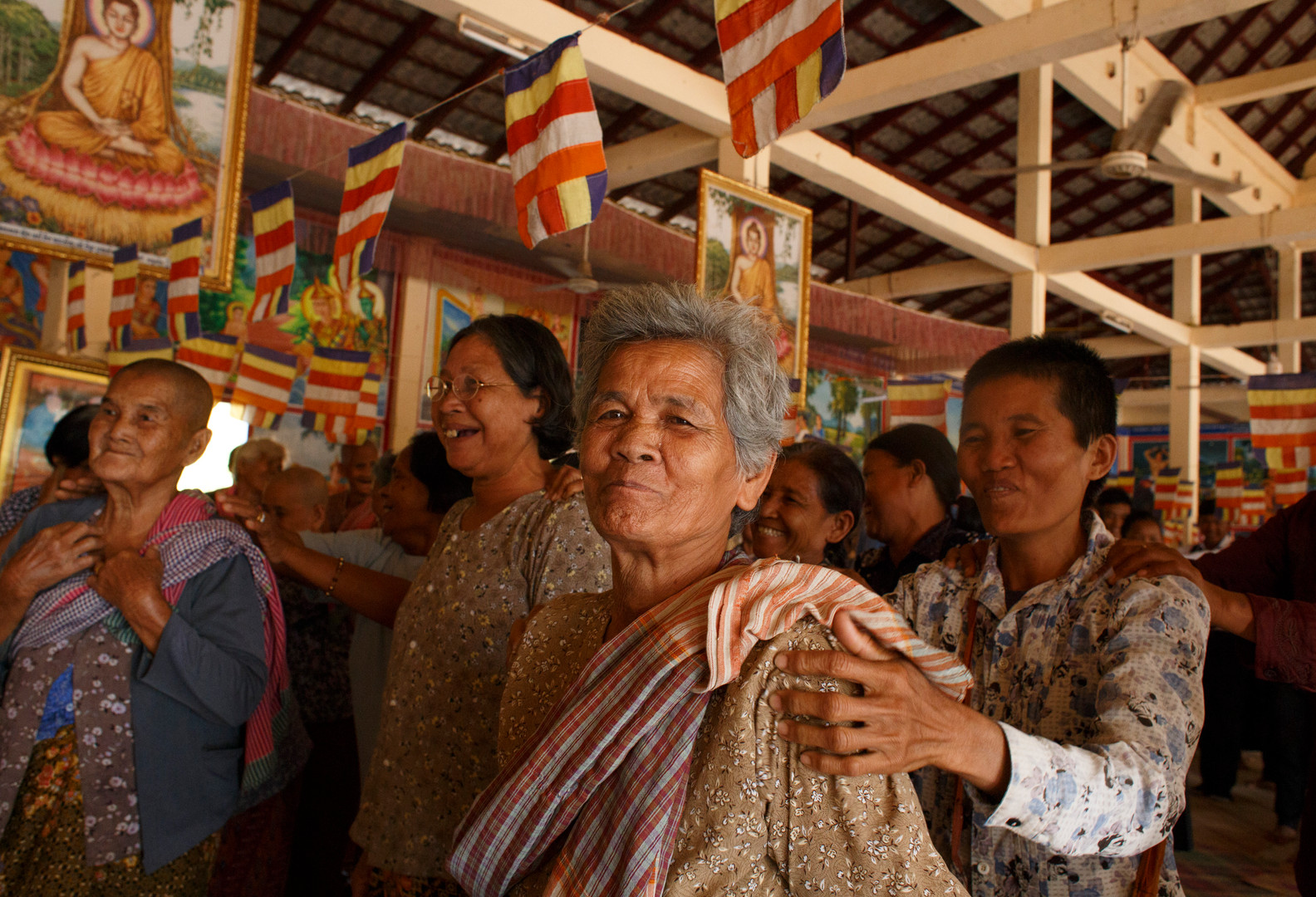 Community members join grounding and relaxing exercise lead by TPO staff at the end of testimonial therapy at Ta Ann Village, Ta Ann Commune, Cambodia on the 18th of January 2018.