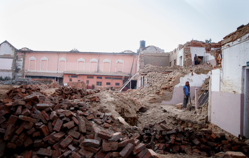 Two men dismantle what remains of a building damaged during the April 2015 earthquake that claimed over 8000 lives and destabilised life as it was known for many others. Lalitpur, Kathmandu, Nepal 2016.