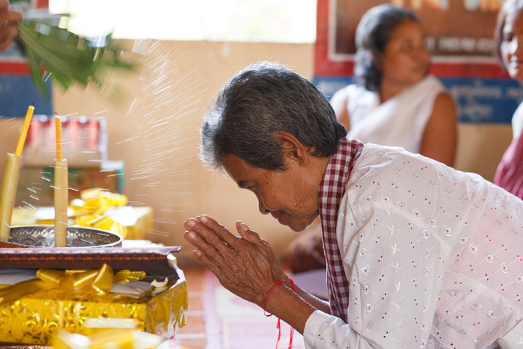Chea Noeurn (68) is blessed by monks at a Buddhist ceremony culminating five days of group therapy organised by the Transcultural Psychosocial organisation for six survivors of the Khmer Rouge at the Ta Ann village, Ta Ann commune,                                  Kralanh district, Siem Reap province.