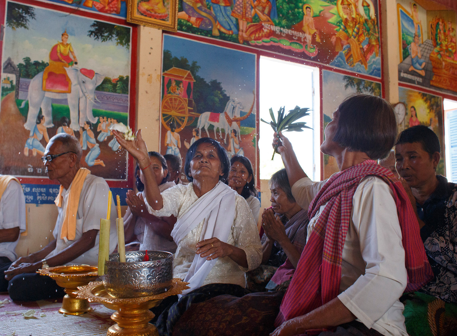 Members of Ta Ann village, Ta Ann commune, Kralanh district, Siem Reap province bless the photographer at a ceremony culminating five days of testimonial therapy for members of the Khmer Rouge with TPO Transcultural Psychosocial Orgainisation on 18th January 2018.