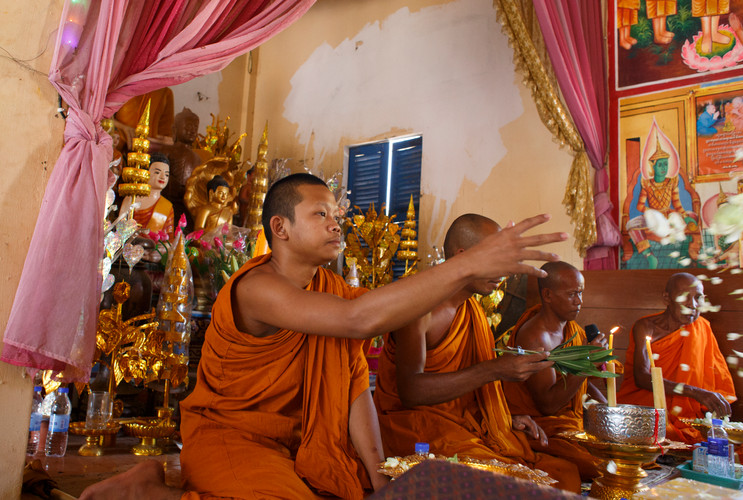 Buddhist monks (from closest to furthest) Boeurn Soeuy (18),  Louhong Ply (38), Chhun Da (44) and Hem Leourm (87) offer blessing to those in attendance and giving testimony of events that transpired during the Khmer Rouge regime at Ta Ann village, Ta Ann commune, Kralanh district, Siem Reap province, Cambodia on 18th January 2018.