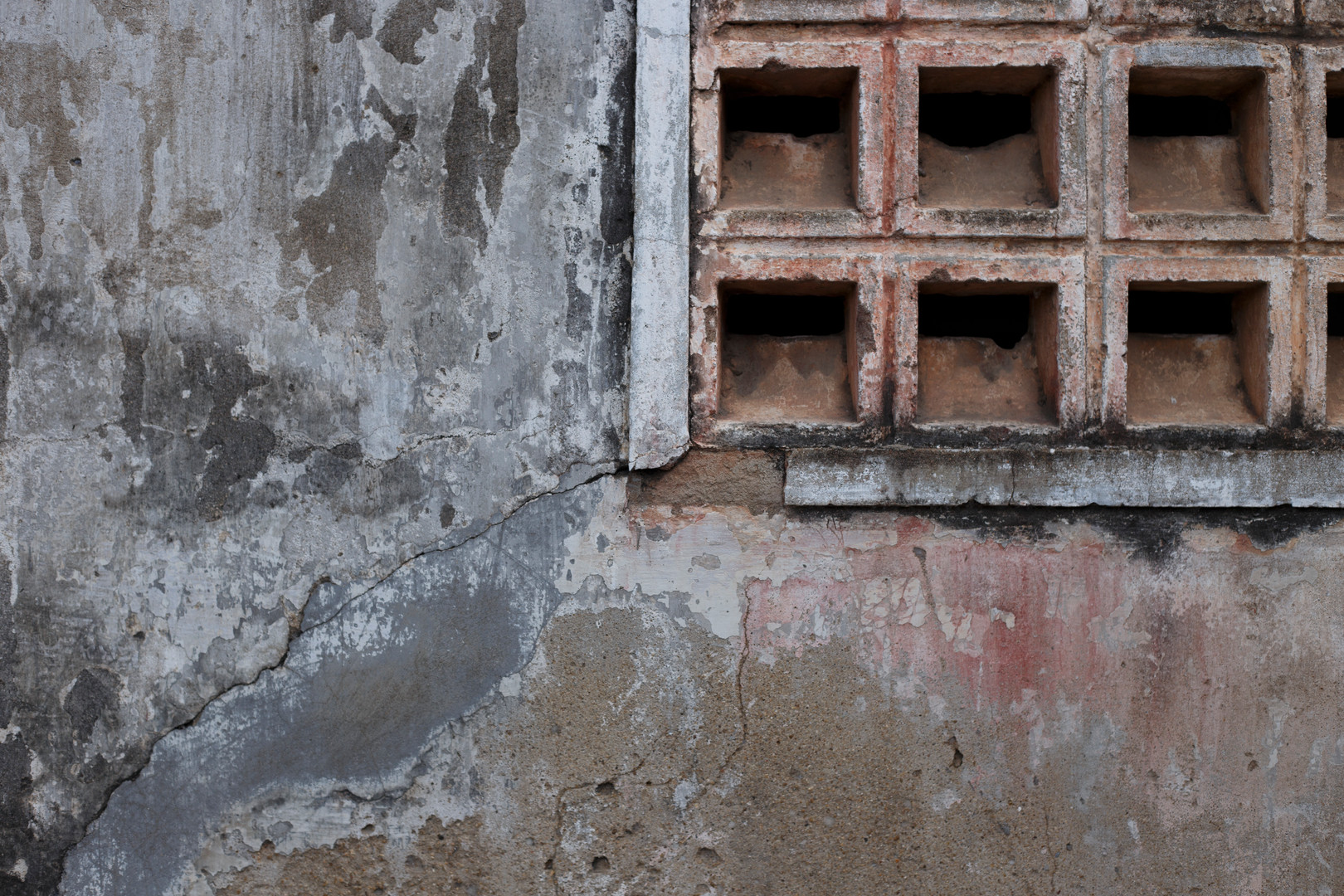A slowing crumbling wall at the Tuol Sleng Genocide Museum, Phnom Penh, Cambodia