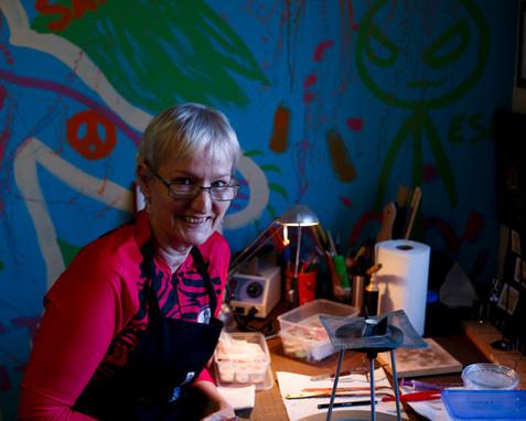 Carol Money, member of breast cancer survivor paddling group Missabittatitti in her study in Brisbane, Queensland, Australia. Carol is a keen amateur jewellry maker.