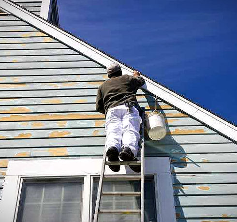 Exterior-Painting-on-a-Ladder_edited.jpg