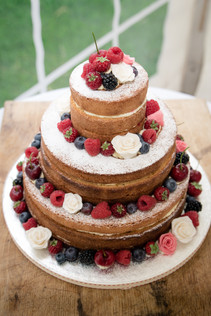 Naked wedding cake with berries
