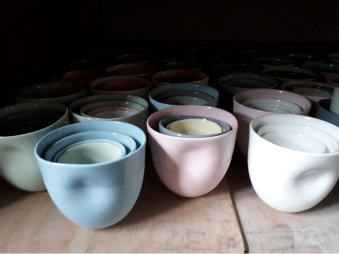 (some of Carola's slipcast work manufactured in Jingdezhen)