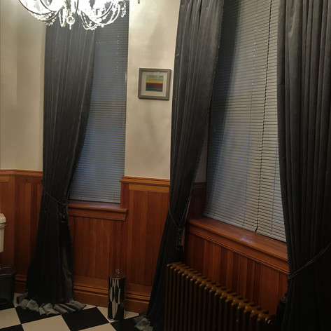 Velvet curtains with trim.