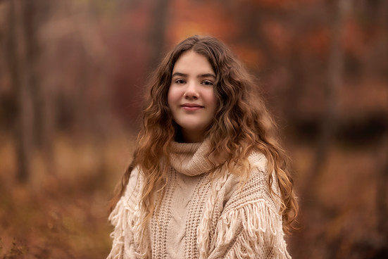 Young girl at Arbor Hills nature preserve during family photo session