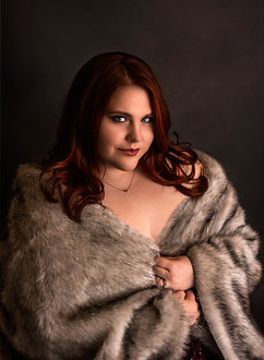 Woman in fur during portrait photography session in Kaufman Texas