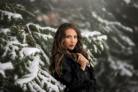 Woman in snow during portrait photography session in Steamboat Colorado