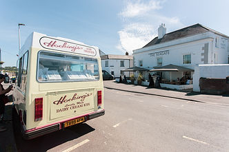 Hockings Ice Cream Van parked on the Quay with The Seagate Hotel in background with tables outside