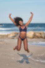 photo-of-happy-woman-in-two-piece-bikini