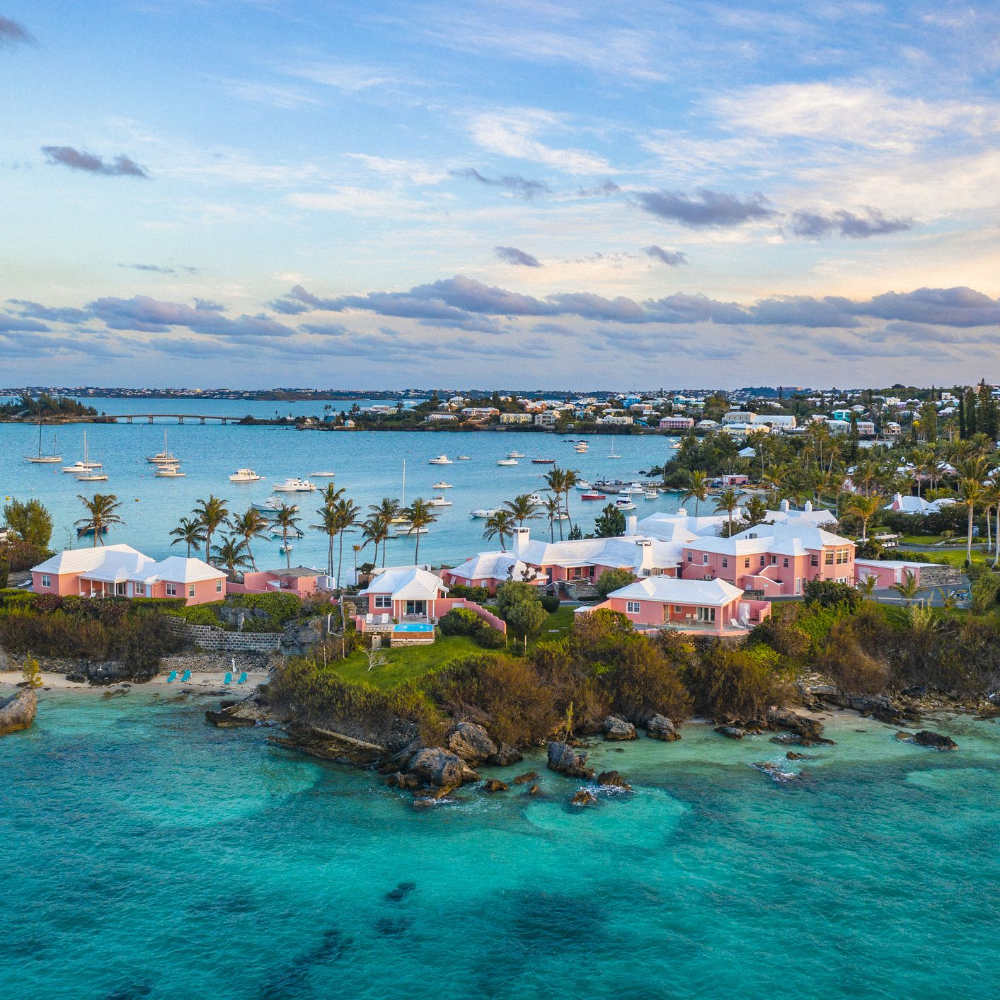 a-tropical-island-with-yachts-and-houses