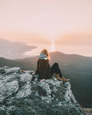 photo-of-woman-sitting-on-rock-4510992.j