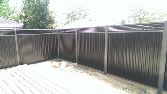 Colorbond Greyridge and Black slotted lattice with sleepers 2