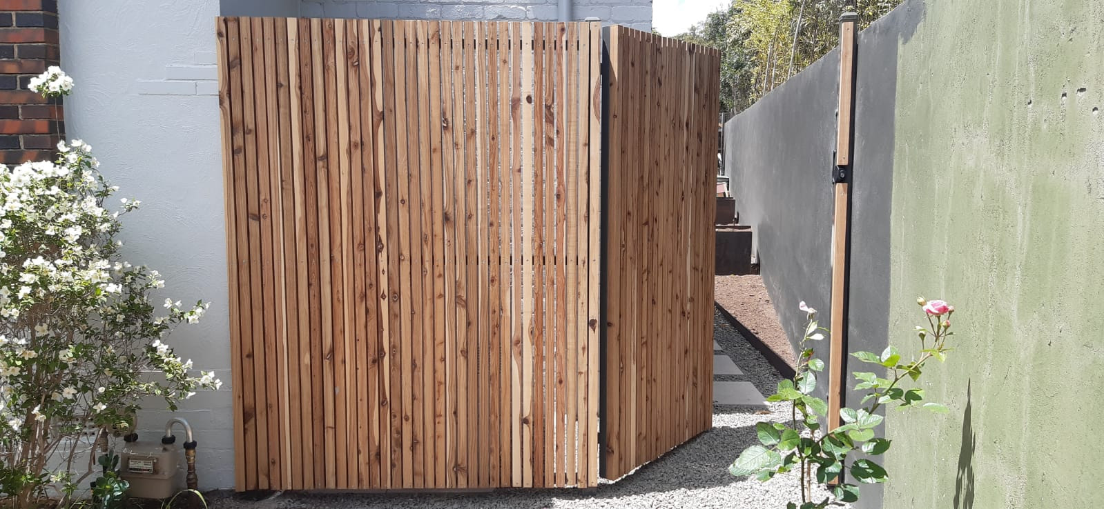 2m high batten fence and single gate