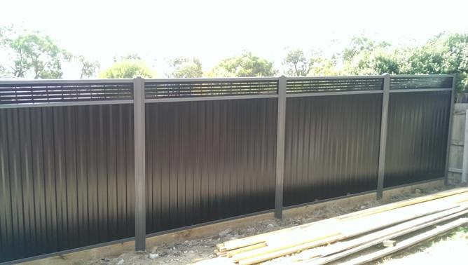 Colorbond Greyridge and Black slotted lattice with sleepers 1