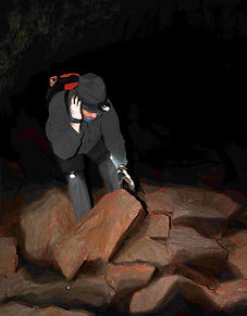 hiker in dark cave climbing on rocks with LED headlamp and LEGLIGHTS