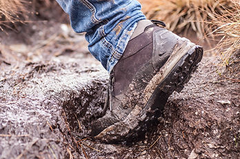 muddy boot, stepping in mud