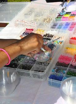 Makena picking beads.jpg