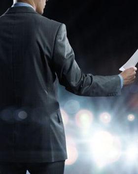 1111-Speaker-standing-on-podium-in-light