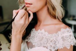 Young beautiful bride applying wedding m