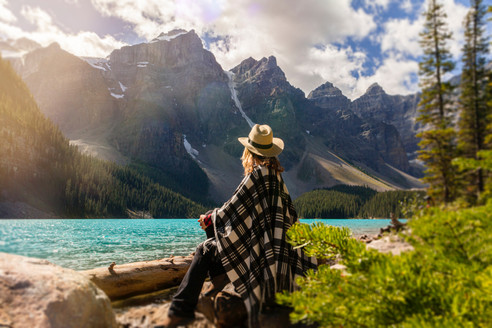 a-woman-sits-on-a-rock-beside-the-lake-2