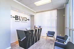 Inside of BLVD Estate. The Reception desk with chairs in our waiting room