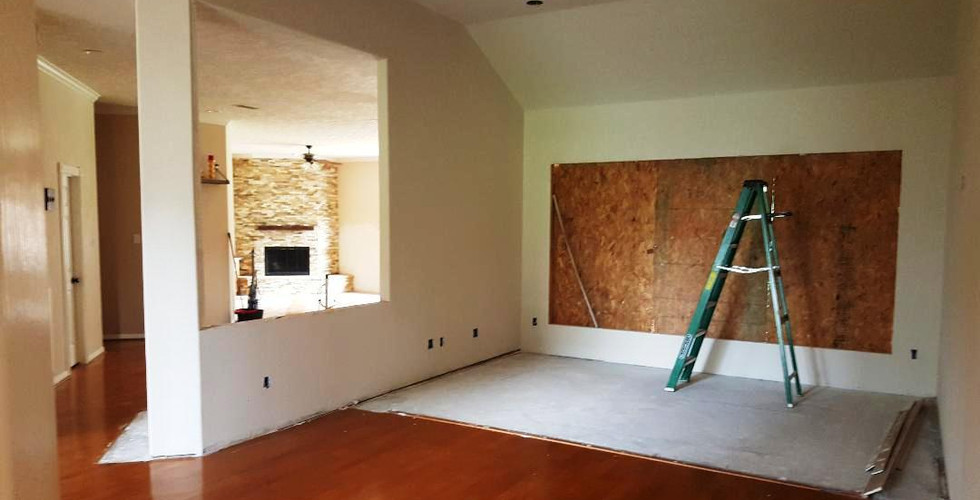 Before (after we poured concrete to extend the living room out)