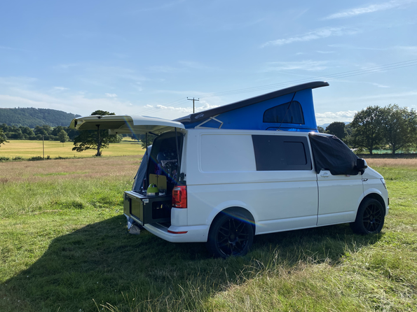 Camper conversion with pop top