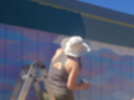 Painting murals and serving the community